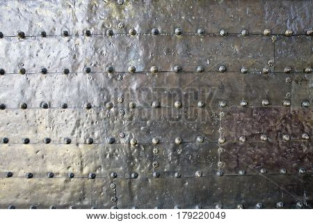 antique metal background surface with rivets. Andalusian style