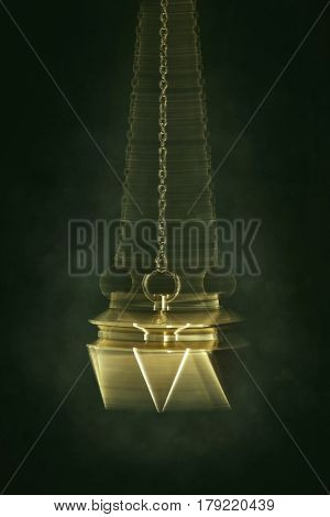 Swinging pendulum used for hypnotism or foretelling