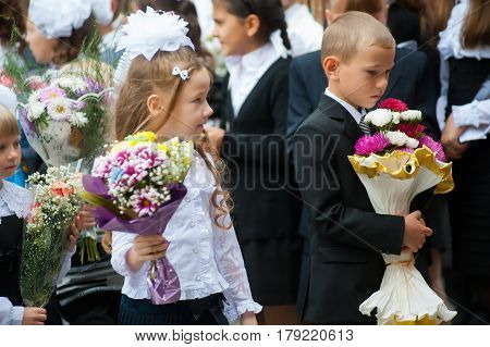 Tyumen, Russia - September 1, 2012: School 43. Primary school children with flowers on the first day of the school year. Feast Day of Knowledge.