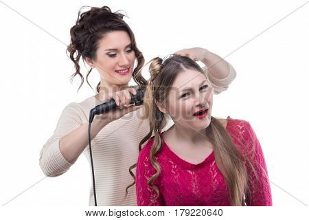 Working hairstylist and surprised woman on white background