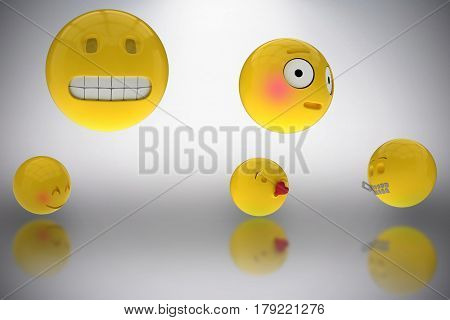 Three dimensional image of various smileys faces reactions against grey background 3d