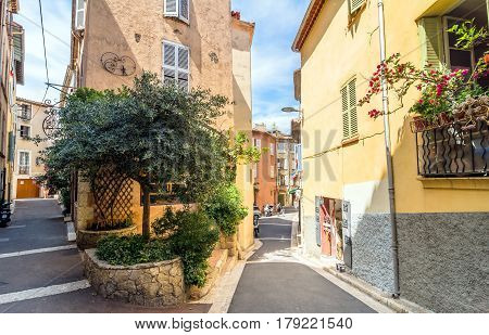 Antibes. France - June 29. 2016: day view of typical narrow street in Antibes France. Antibes is a popular seaside town in the heart of the Cote d'Azur.
