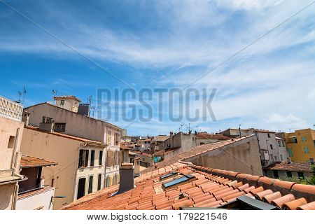 Antibes France - June 29 2016: day view of old town roofs and skyline in Antibes France. It is one of the most well known resorts on the Cote d'Azur located between Nice and Cannes.