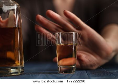 woman hand refused a glass of whiskey