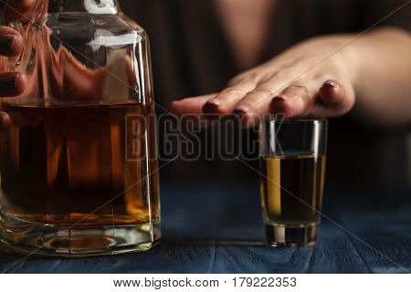 Woman stoped to drink more by hands