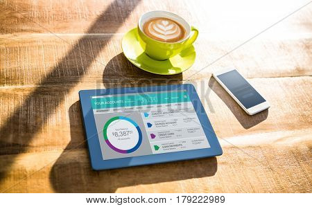 Graphic image of bank account web site against cup of coffee and tablet pc