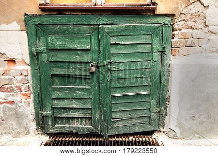 Ancient wooden door that leads to a underground storehouse textured in a rough vintage style