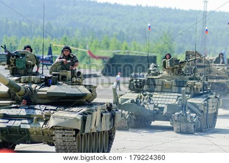 Nizhniy Tagil, Russia - July 12. 2008: Modernized tank T-72, BMR-3M armoured deminer and guard move on shooting demonstration range. RAE-2008 exhibition