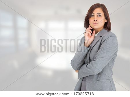 Digital composite of Anxious businesswoman against bright background
