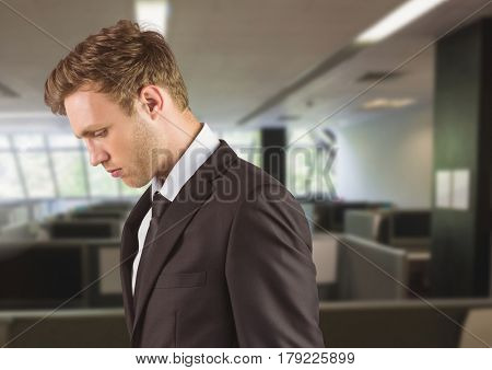 Digital composite of Sad disappointed businessman in office