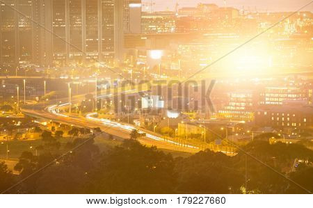 Blurry animated flare against illuminated cityscape