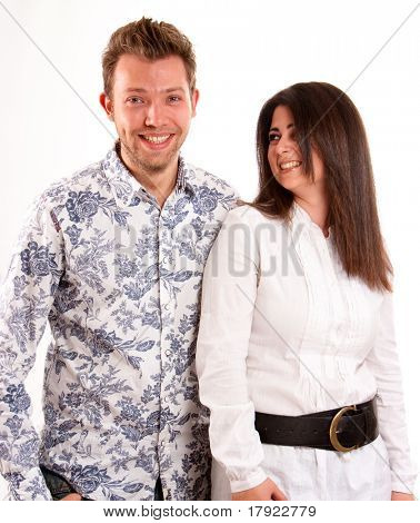 Isolated picture of a laughing young couple in a white background