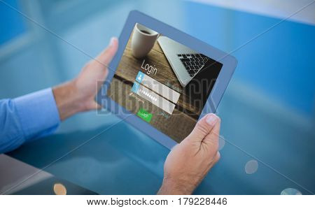 Businessman using his tablet against close-up of login page