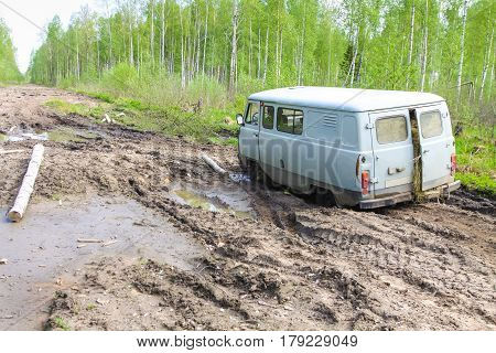 Car stuck in the muddy forest road