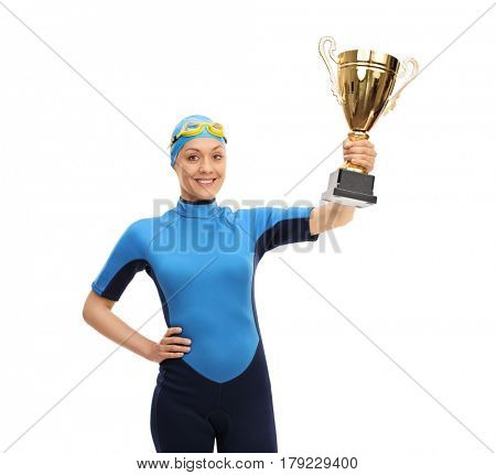 Happy female swimmer holding a golden trophy isolated on white background