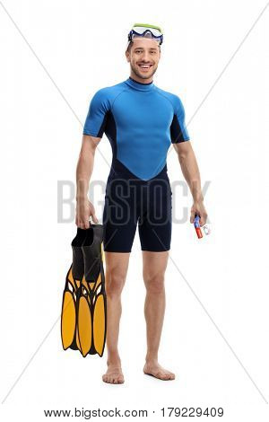 Full length portrait of a guy in a wetsuit with snorkeling equipment isolated on white background