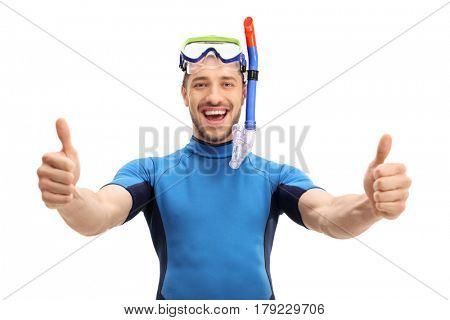 Joyful guy in a wetsuit with a diving mask and a snorkel making a thumbs up gesture isolated on white background
