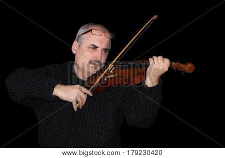 Portrait of a Caucasian man playing the violin on a black background.