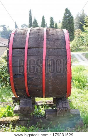 Old wooden barrel with red circles for storing wine.