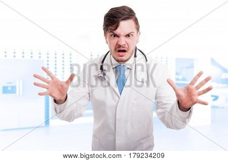 Angry Young Doctor Showing Rage And Screaming