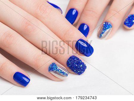 Beautifil blue manicure with rhinestone.. Nail Design. Close-up.