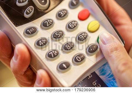 Paris, France - October 08, 2015: Close-up Of Female Hand Doing Purchase Through Payment Machine