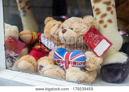 WINDSOR UK - MARCH 18 2017: Teddy bears in a souvenir shop window in the popular tourist town on Windsor in March 2017.