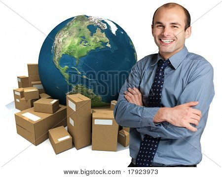 Happy businessman with a world map and a pile of  packages on the background