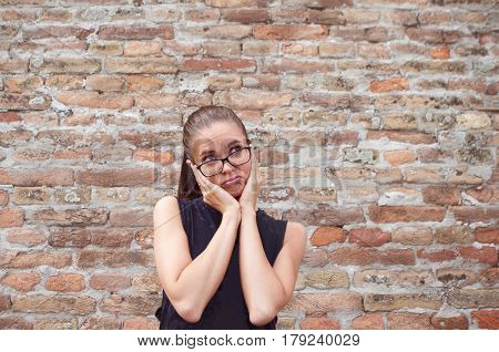 Young beautiful woman with bored empty expression background