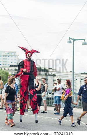 Stockholm, Sweden – July 30, 2016: Buffoon On Stilts During Stockholm Pride Parade On Hantverkargata