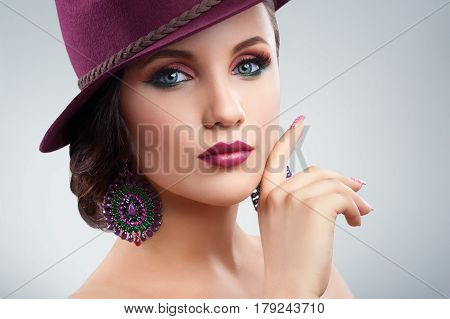 Beauty in style. Close up studio portrait of a beautiful stylish young fashion model wearing colorful eye shadow and purple lipstick copyspace feminine beauty fashionable style perfection skin makeup
