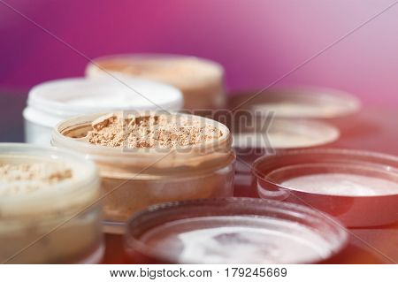 Background with mineral make up powder. Products for make up foundation and matt skin