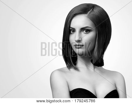 Classy lady. Black and white studio shot of an attractive young classy elegant woman looking to the camera copyspace confident graceful elegant glamorous beauty style concept