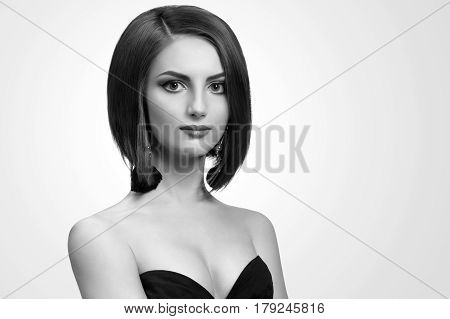 True lady. Gorgeous young woman posing elegantly wearing black dress copyspace beauty fashion feminine stylish glamour concept
