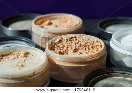 Beige make-up powder for matt foundation. Mineral powder of nude colors selective focus