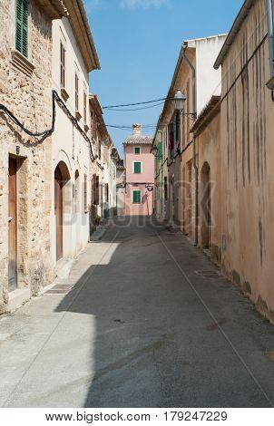 ALCUDIA, SPAIN - MARCH, 2017: Alley in Alcudia on Mallorca island
