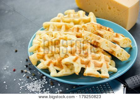 Savory cheese waffles on plate close up