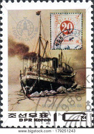 UKRAINE - CIRCA 2017: A postage stamp printed in DPR Korea shows icebreaker circa 1986
