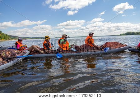 Canoeing on the Kama river, Doksha district, Russia - 07.06.2014: Editorial. Young people rest on a canoes.