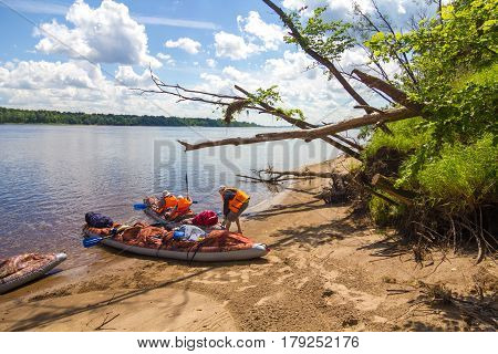 Inflatable canoes on the Shoreline. Canoing on the river.
