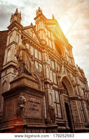 The Basilica di Santa Croce (Basilica of the Holy Cross) with the monument to Dante in the foreground, Florence, Italy