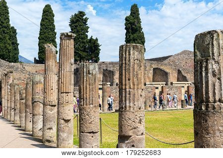 POMPEII, ITALY - MAY 13, 2014: The ruins of city. Pompeii is an ancient Roman city died from the eruption of Mount Vesuvius in 79 AD.