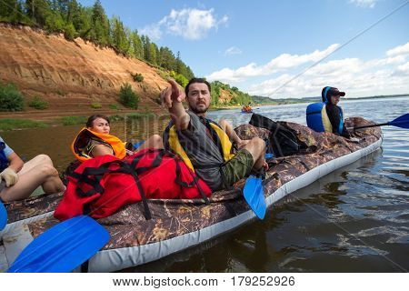 Canoeing on the Kama river, Doksha district, Russia - 07.06.2014: Editorial. The group instructor indicates