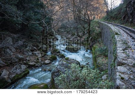 Touristic cog railway and river  in Vouraikos gorge, Peloponnese, Greece