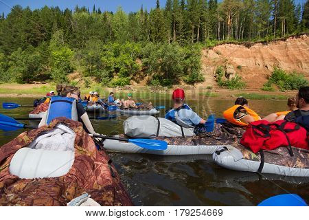 Canoeing on the Kama river, Doksha district, Russia - 07.06.2014: Editorial. Group of canoers