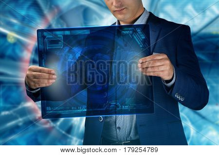 Technology Concept. Businessman Presses A Button On The Virtual Screen Tablet Future Date.