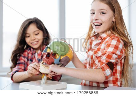 This is fun. Bright creative pretty children attending biology class and studying human anatomy while enjoying the process