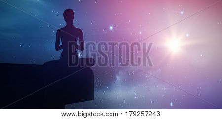 Fit woman meditating eyes closed against stars twinkling in night sky