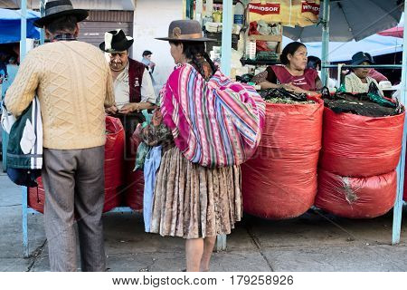 Indigenous Bolivian couple selling coca leaf at the market. October 5 2012 - Sucre Bolivia