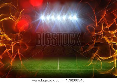Ball of fire against pitch under illuminated spotlights 3d